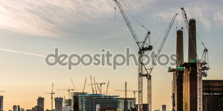 Cranes constructing buildings