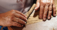 cigar. cigars. Hand-rolled cigars. Cigar manufacturing. Tobacco roller. Tobacco simply leaves, Tobacco leaf