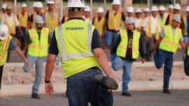 Skanska employees stretch and flex