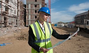 women on building site keeping website papers